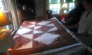 Another Hatchett Job, quilt, quilting, hand quilting, quilt frame, hand quilting in frame, log cabin, log cabin quilt, frugal life, crafts, sewing